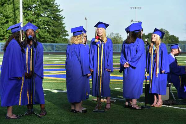 "Members of the 2017 graduating class of Seymour High School perform the senior song, ""Castle on a Hill"" by Ed Sheeran, during commencement on Wednesday, June 14, 2017."