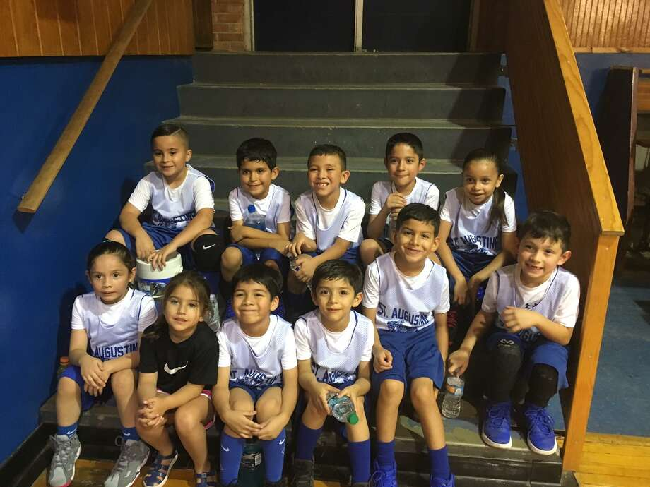 The Blessed Sacrament incoming second grade basketball team is participating in a summer league. Pictured from left in the top row are Edi, Roman, Juan, Gio and Katie. In the bottom row are Rebecca, Amaly, Liam, Andy, Dallas and Markus. Photo: Courtesy Photo