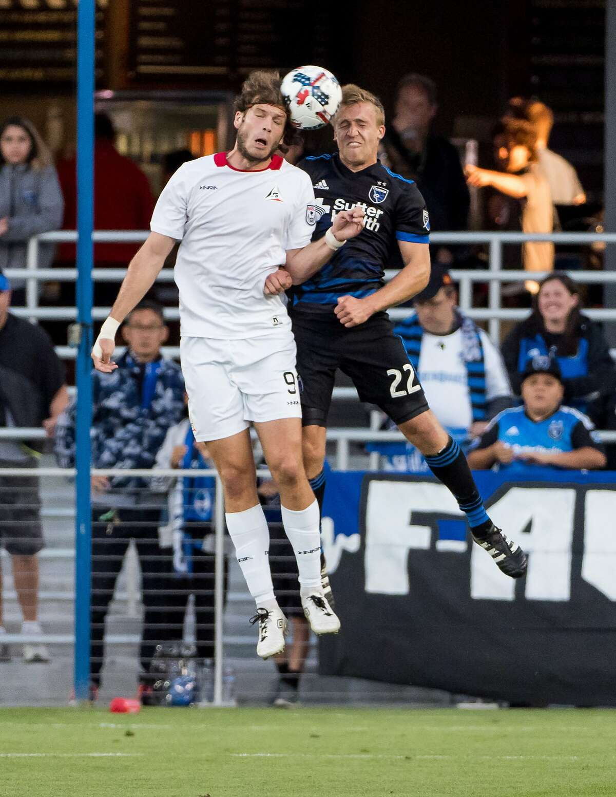 San Francisco Deltas forward Tommy Heinemann (9) and San Jose Earthquakes forward Tommy Thompson (22) go up for a header during the US Open Cup game at Avaya Stadium in San Jose on June 14, 2017.