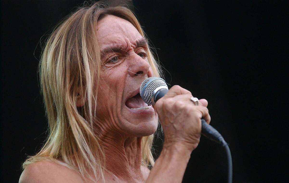 U.S. rock singer Iggy Pop performs on the Grand Stage of the Sziget (Island) Festival on the Shipyard Island in Budapest, Tuesday, Aug. 15, 2006, on the last day of the event. Hundreds of thousands visitors from all over Europe attended this year's week-long youth festival, one of the biggest cultural festivals of the continent. (AP Photo/MTI,Mate Nandorfi)