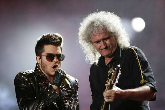FILE - In this Sept. 19, 2015 file photo, Adam Lambert, left, and Brian May of the Queen + Adam Lambert perform at the Rock in Rio music festival in Rio de Janeiro, Brazil. Many of the rock �n� roll bands that were huge in 1977 will comprise a big part of the summer concert market 40 years later. Concert industry executives say nostalgia acts are still reliable sellers, with satellite and classic rock radio keeping their hits alive. (AP Photo/Felipe Dana, File)