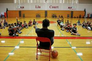 Miami Heat forward Justise Winslow, center, calls on students at his skills camp invitational last year. Winslow will return to host the third annual Justise Winslow Invitational Clinic June 24 and 25 at St. John's, his alma mater. Winslow credits the Houston basketball scene with shaping and molding him, and says it's both exciting and rewarding to be in a position to give back and help nurture it, in turn.