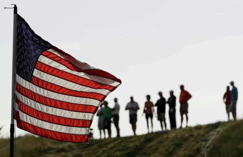 Fans stand near the 10th hole during the first round of the U.S. Open golf tournament Thursday, June 15, 2017, at Erin Hills in Erin, Wis. Photo: David J. Phillip, AP / Copyright 2017 The Associated Press. All rights reserved.
