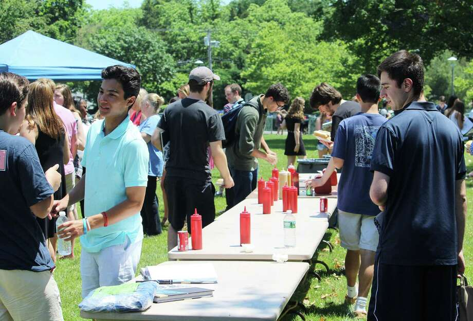 Fairfield Ludlowe High School students and staff enjoy the senior picnic and yearbook signing June 14, 2017 at the Fairfield, Conn. school. Photo: Laura Weiss / Hearst Connecticut Media / Fairfield Citizen