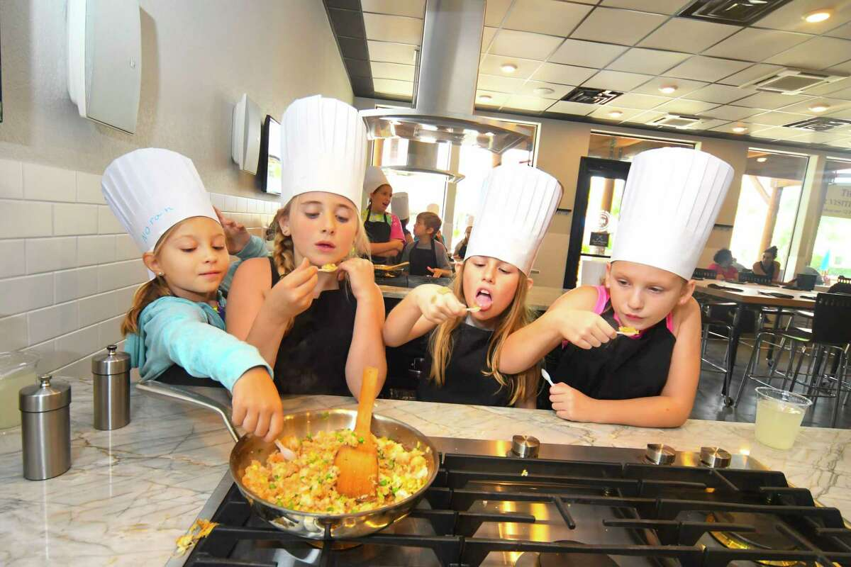The cooking team of Nora Reinhardt , from left, Makenna Deal, Avery Boyd and Brianna Thomas all try a taste of the teriyaki stir fry.