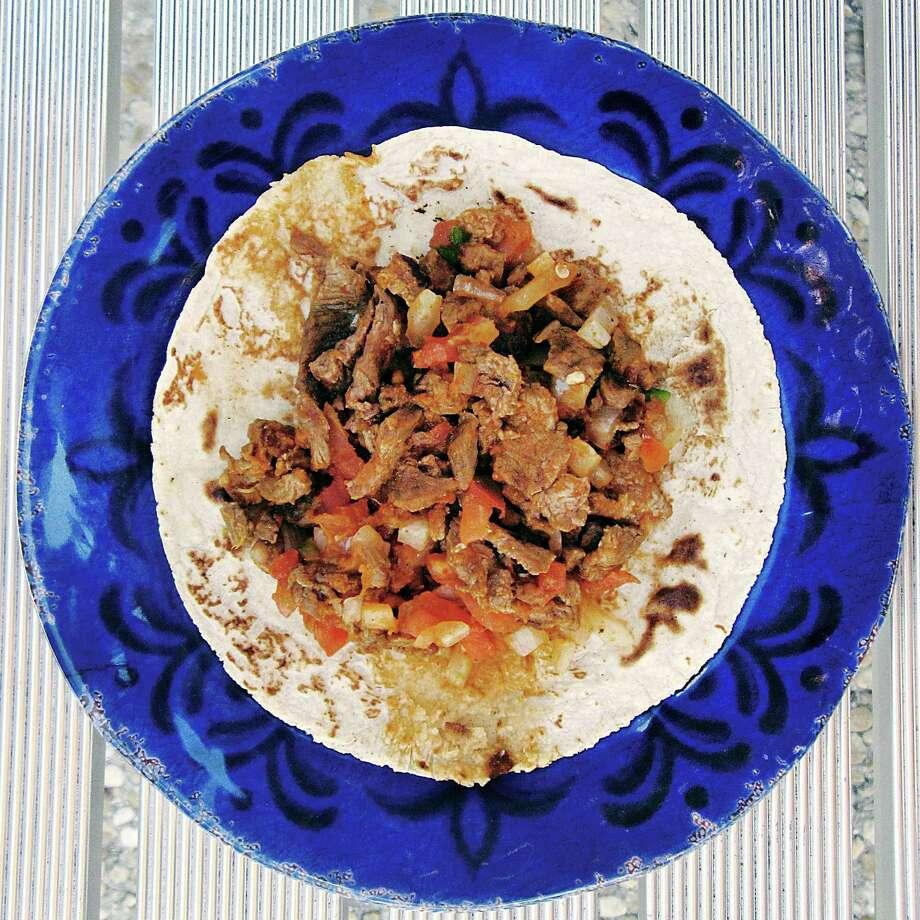 Carne asada a la mexicana taco on a handmade corn tortilla from El Potosino Mexican Restaurant #2. Photo: Mike Sutter /San Antonio Express-News