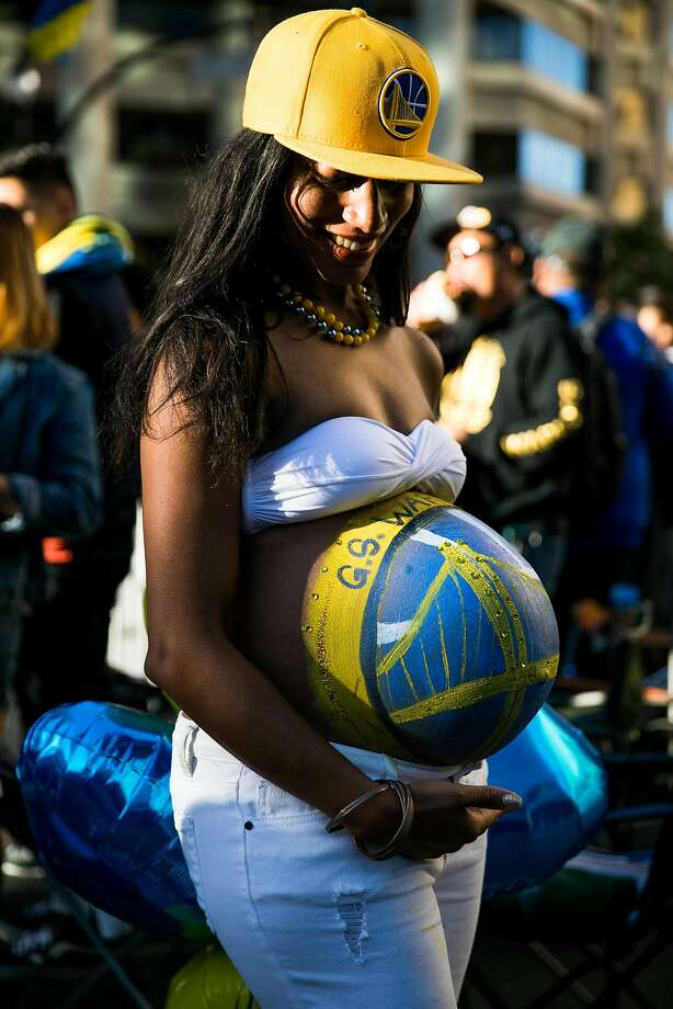 Jasmine Culp poses for a portrait as thousands of fans descend to the Warriors Championship Parade in Oakland, Calif. Thursday, June 15, 2017. Culp is expecting  in mid-July. Photo: Mason Trinca, Special To The Chronicle