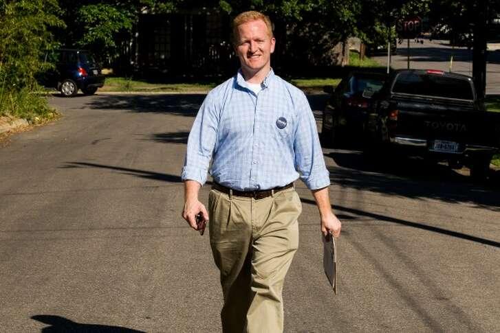 Derrick Crowe, seeking a Texas U.S. House seat, strolls in a South Austin neighborhood while greeting voters Saturday May 13, 2017 (DAVE CREANEY/Austin American-Statesman).
