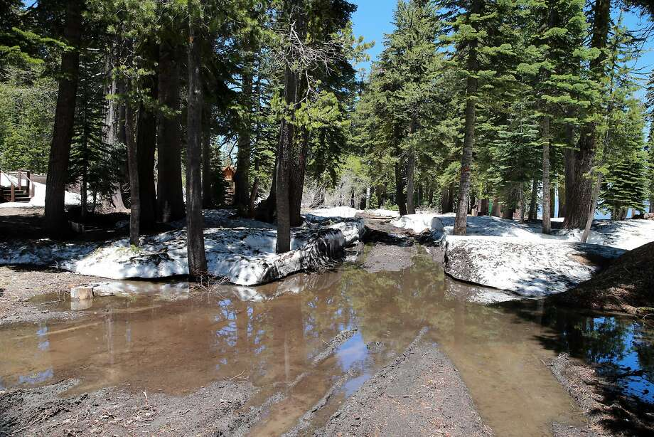 Dirt roads inside the Berkeley Echo Lake Camp remain impassable as snow continues to melt outside South Lake Tahoe. Photo: Lance Iversen, San Francisco Chronicle