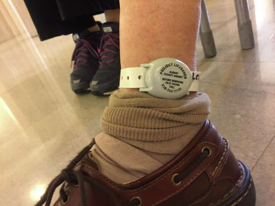 Frank DiCesare wears a Project Lifesaver transmitter near his ankle. Photo: Claire Hughes / Times Union