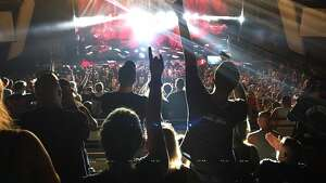 Fans of Slipknot through up the rock-on gesture at a recent concert at the Saratoga Performing Arts Center. Kiss bassist Gene Simmons says he invented the ubiquitous gesture and wants to trademark it.