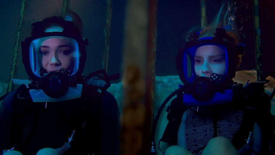 "Sisters Lisa (Mandy Moore, left) and Kate (Claire Holt) get trapped underwater when their shark-cage excursion goes awry in ""47 Meters Down."" Photo: Entertainment Studios Motion Pictures"