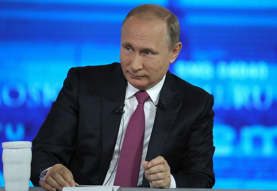 "Russian President Vladimir Putin says U.S. ""political infighting"" is blocking better relations. Photo: Mikhail Klimentyev, Associated Press"