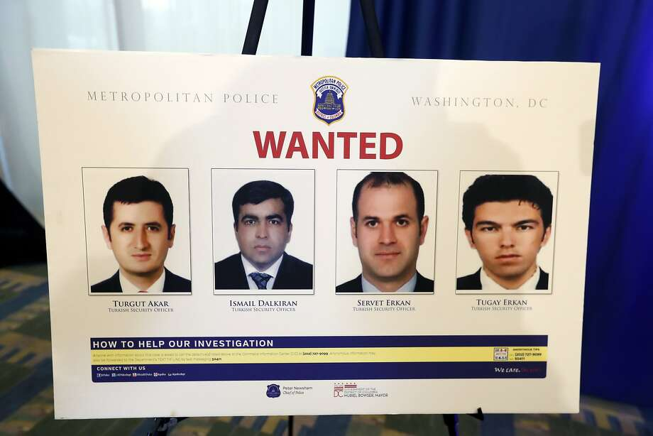 Photos of Turkish agents facing criminal charges are shown at a news conference in Washington. Photo: Alex Brandon, Associated Press