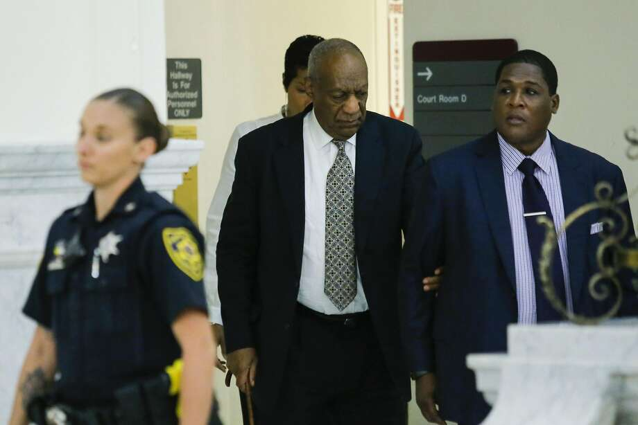 Bill Cosby (center) walks to the courtroom on the fourth day of jury deliberations of his sexual assault trial in Norristown, Pa. The case is one of America's biggest celebrity trials in years. Photo: EDUARDO MUNOZ ALVAREZ, AFP/Getty Images