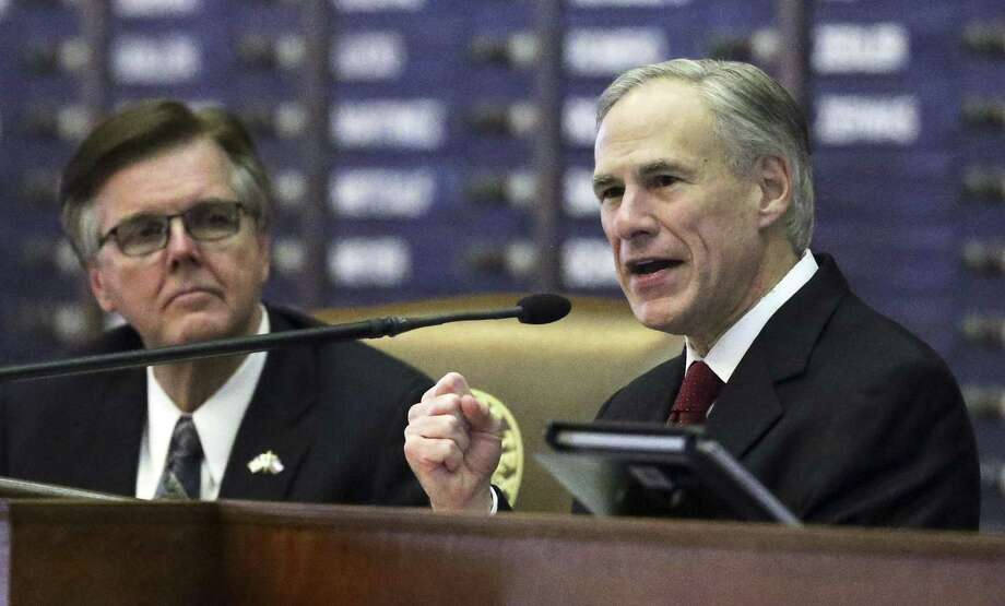 The decision by Gov. Greg Abbott, seen on Jan. 31, 2017, to load the special session agenda with conservative priorities was seen by some as a masterstroke to immunize himself against criticism by Lt. Gov. Dan Patrick (left) and others. Photo: Tom Reel /San Antonio Express-News / 2017 SAN ANTONIO EXPRESS-NEWS