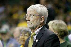 FILE - In this Nov. 14, 2016 file photo, Baylor University Interim President Dr. David Garland watches play during an NCAA college basketball game against UCLA on  in Waco, Texas.  A former Baylor University student who says she was raped by two football players filed a federal lawsuit Friday, Jan 27, 2017 against the school that alleges there were dozens more assaults of women involving other players. (AP Photo/Tony Gutierrez)