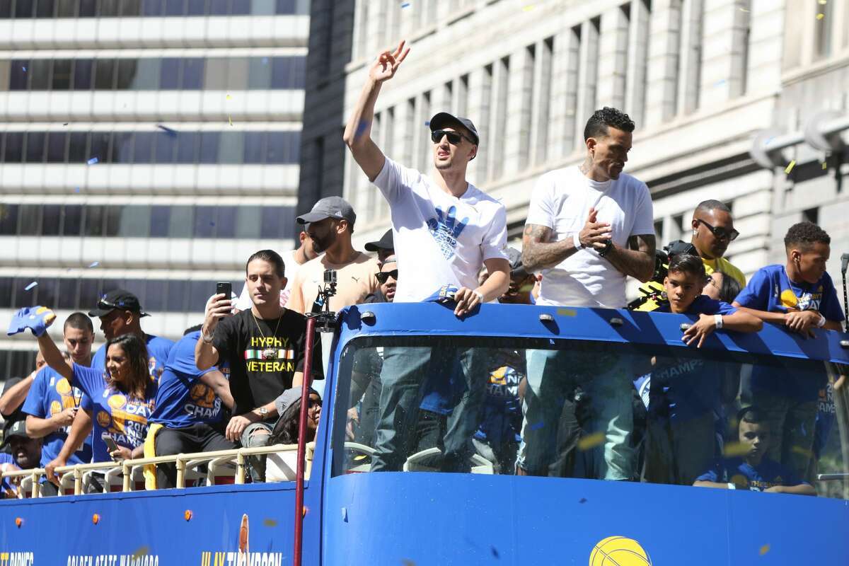 Rapper G-Eazy (black shirt) rides on the bus with Klay Thompson and Matt Barnes.