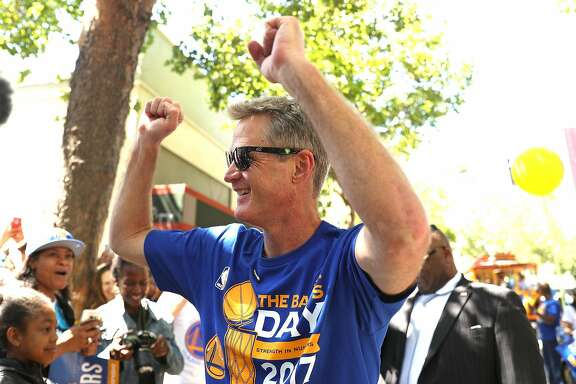 Golden State Warriors' head coach Steve Kerr acknowledges the cheers during championship parade on Broadway in Oakland, Calif., on Thursday, June 15, 2017.