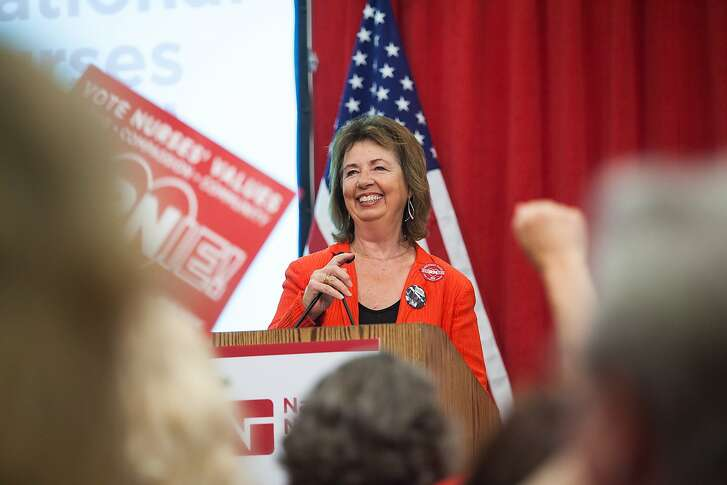 "National Nurses United executive director RoseAnn Demoro speaks to members on Monday, Aug. 10, 2015, at NNU's headquarters in Oakland, California. NNU, the nation?'s largest organization of nurses, hosted a ?""Brunch with Bernie"" where nurses throughout the nation joined by phone and in person to speak with Vermont Sen. Bernie Sanders."