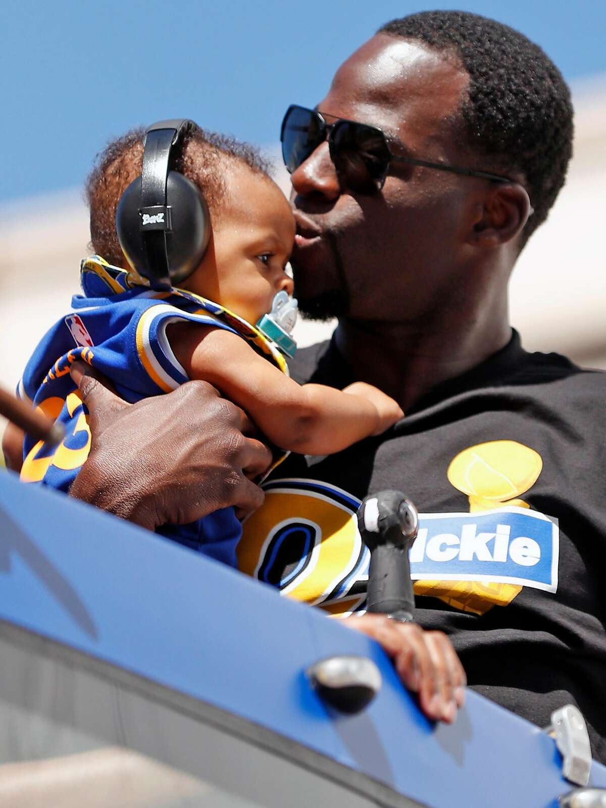 Golden State Warriors' Draymond Green kisses his son, Draymond, Jr., during championship parade on Broadway in Oakland, Calif., on Thursday, June 15, 2017.