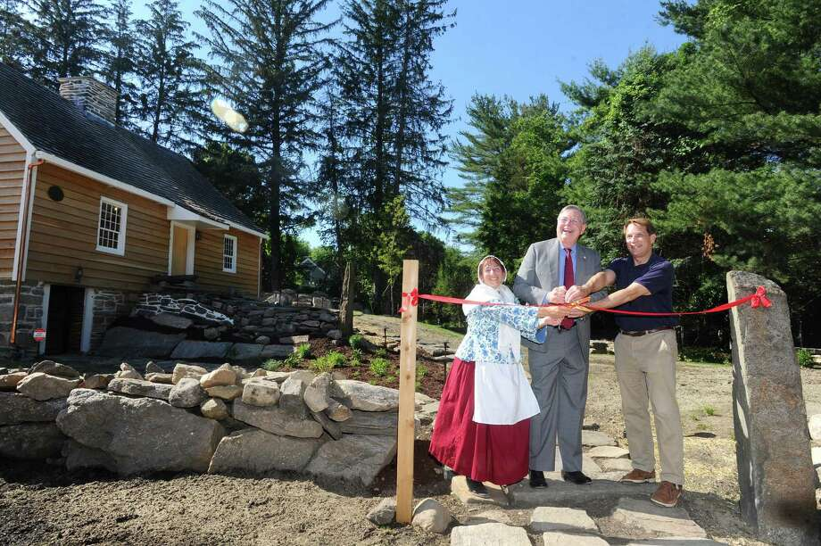 From left, Stamford Historical Society chairman Pam Coleman, Stamford mayor David Martin and Stamford Historical Society president and executive director Thomas Zoubek cut the ribbon to the historic Hoyt-Barnum house on High Ridge Rd. in Stamford, Conn. on Wednesday, June 14, 2017. Stamford's oldest building was moved from its original location on Bedford St. to its new location next to the Stamford Historical Society and will finally open for the first time since it was relocated in November. Photo: Michael Cummo / Hearst Connecticut Media / Stamford Advocate