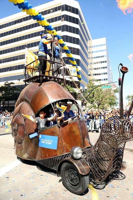 Oakland Mayor Libby Schaaf (upper right) takes part in the Golden State Warriors' championship parade Thursday on Broadway in Oakland. Photo: Scott Strazzante, The Chronicle