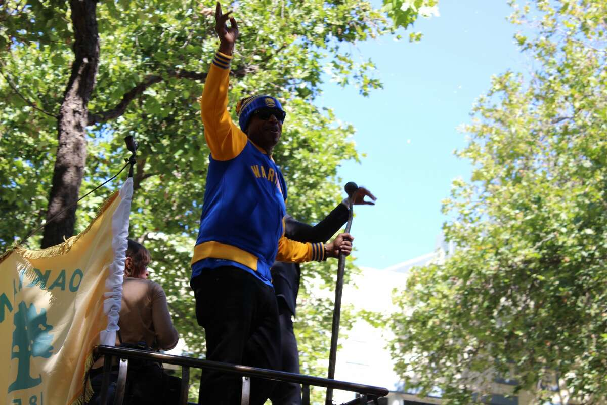 MC Hammer waves to the crowd during the Warriors victory parade in Oakland on June 15, 2017.