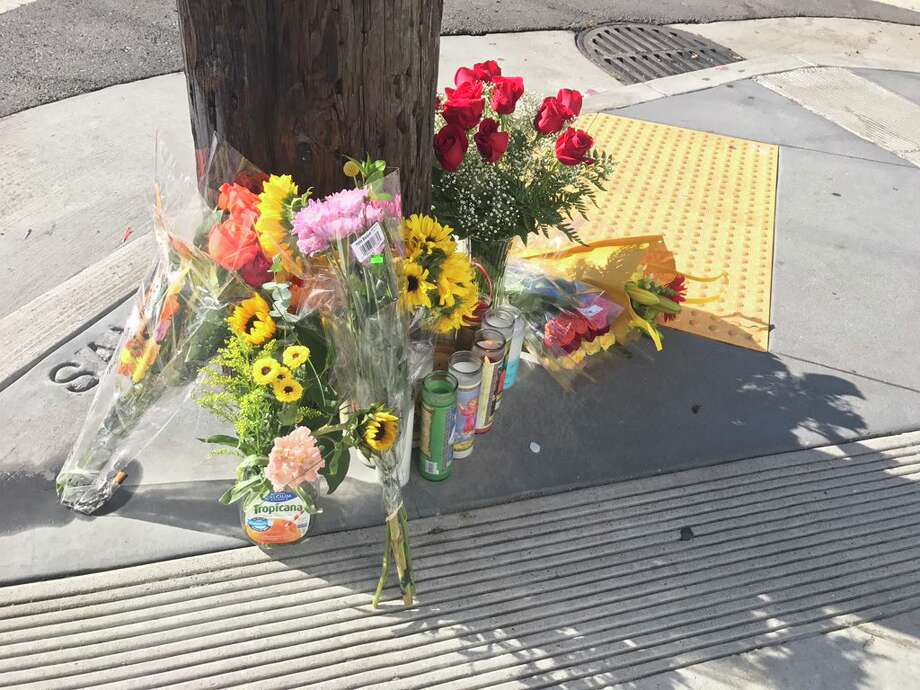 A small memorial is shown in the aftermath shooting of Wednesday's UPS shooting in Potrero Hill, San Francisco. Photo: Filipa Ioannou/ The Chronicle