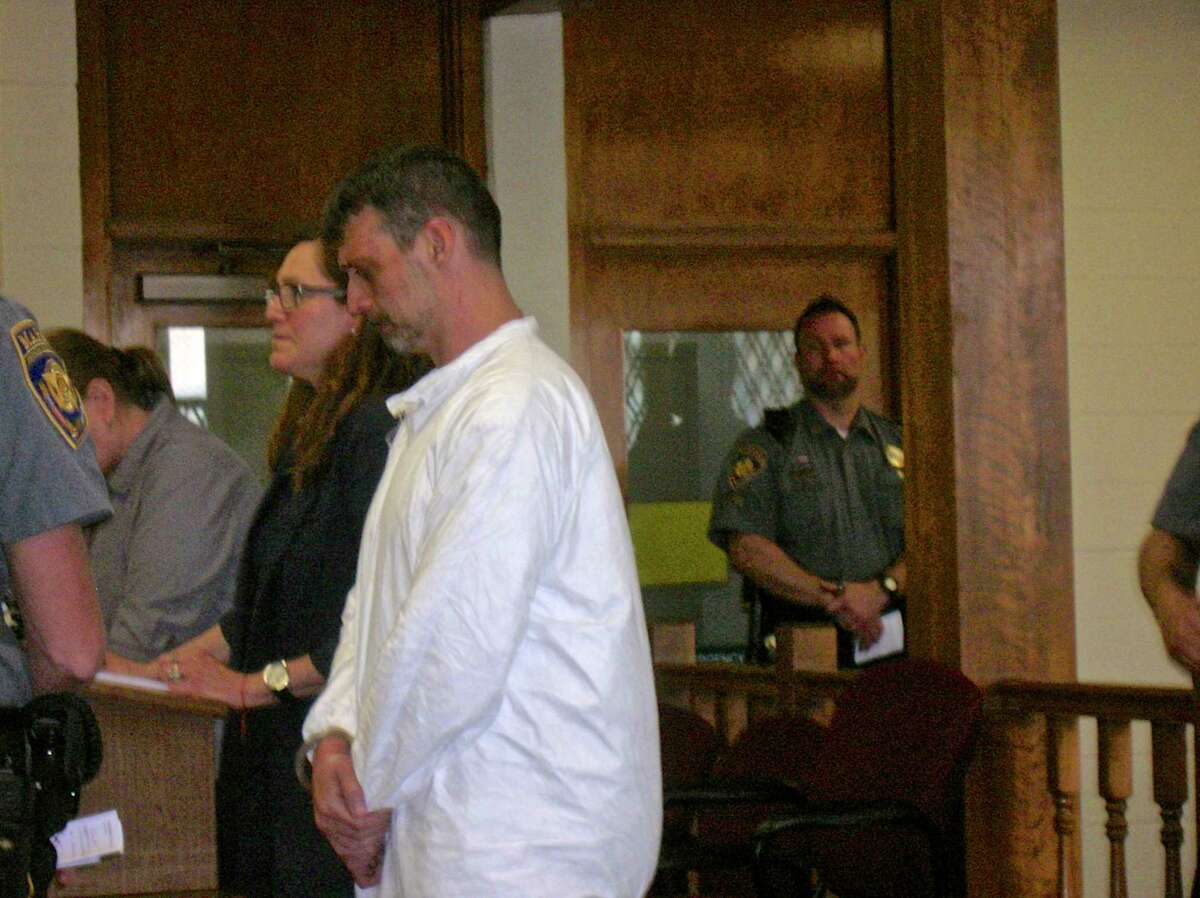 Bethel resident Mark Benoit stands beside his attorney, Susan Filan, during his arraignment in Bantam Superior Court last Juneon home invasion, assault and stalking charges.