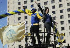 Oakland Mayor Libby Schaaf, right, and MC Hammer wave at fans during a parade and rally in honor of the Golden State Warriors, Thursday, June 15, 2017, in Oakland, Calif., to celebrate the team's NBA basketball championship. (AP Photo/Marcio Jose Sanchez)