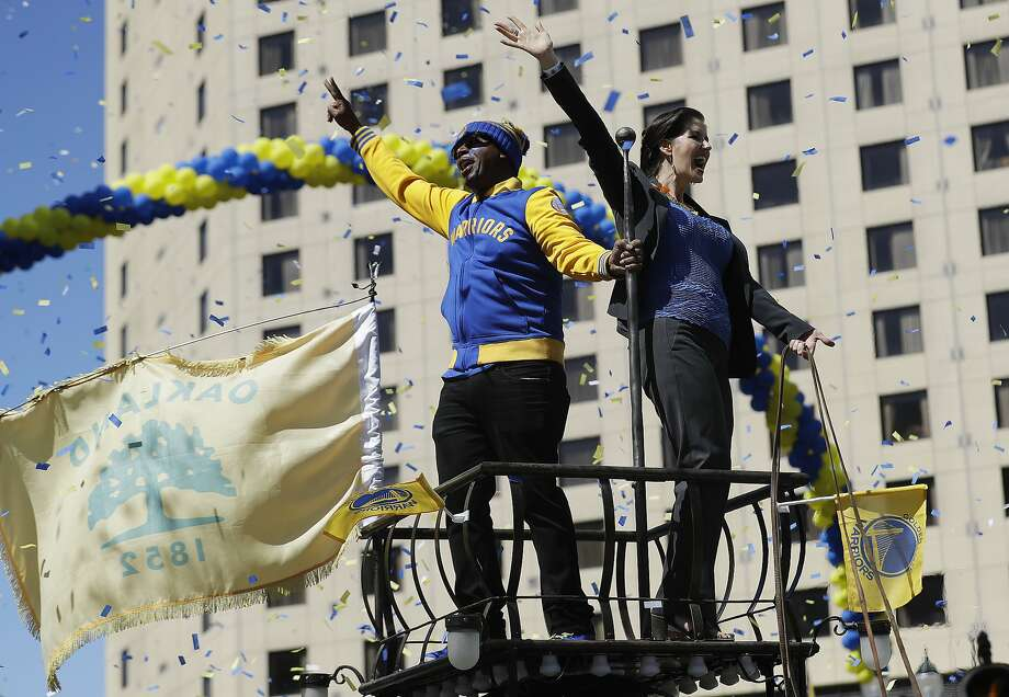 Oakland Mayor Libby Schaaf, right, and MC Hammer wave at fans during a parade and rally in honor of the Golden State Warriors, Thursday, June 15, 2017, in Oakland, Calif., to celebrate the team's NBA basketball championship. (AP Photo/Marcio Jose Sanchez) Photo: Marcio Jose Sanchez, Associated Press