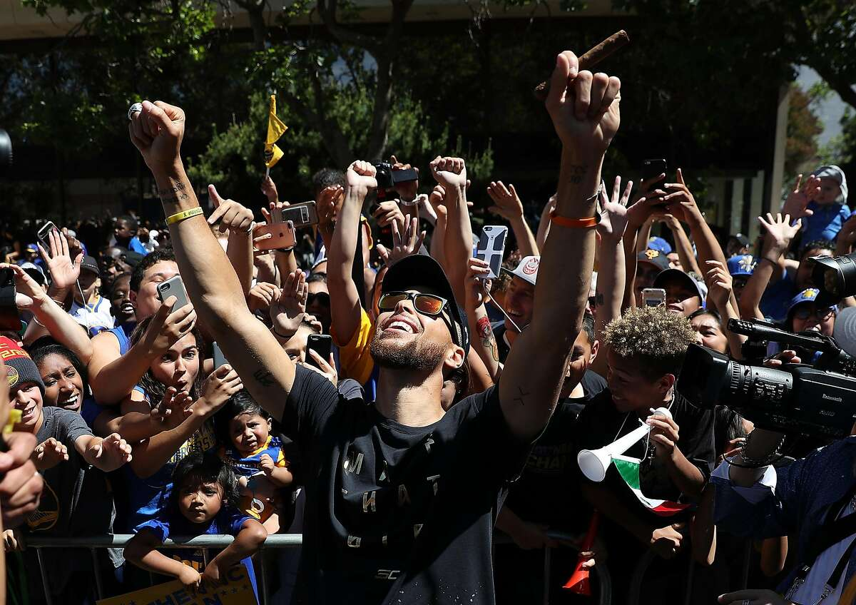 OAKLAND, CA - JUNE 15: Golden State Warriors Stephen Curry celebrates with fans during the Warriors Victory Parade on June 15, 2017 in Oakland, California. An estimated crowd of over 1 million people came out to cheer on the Golden State Warriors during their victory parade after winning the 2017 NBA Championship. (Photo by Justin Sullivan/Getty Images)