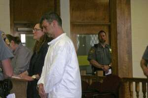 Bethel resident Mark Benoit stands beside his attorney, Susan Filan, during his arraignment in Bantam Superior Court Thursday on home invasion, assault and stalking charges.