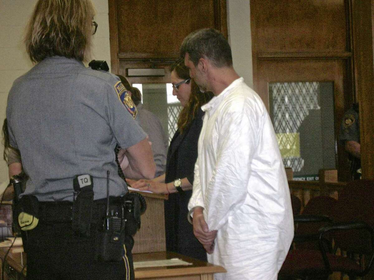 Bethel resident Mark Benoit stands beside his attorney, Susan Filan, during his arraignment in Bantam Superior Court last June on home invasion, assault and stalking charges.