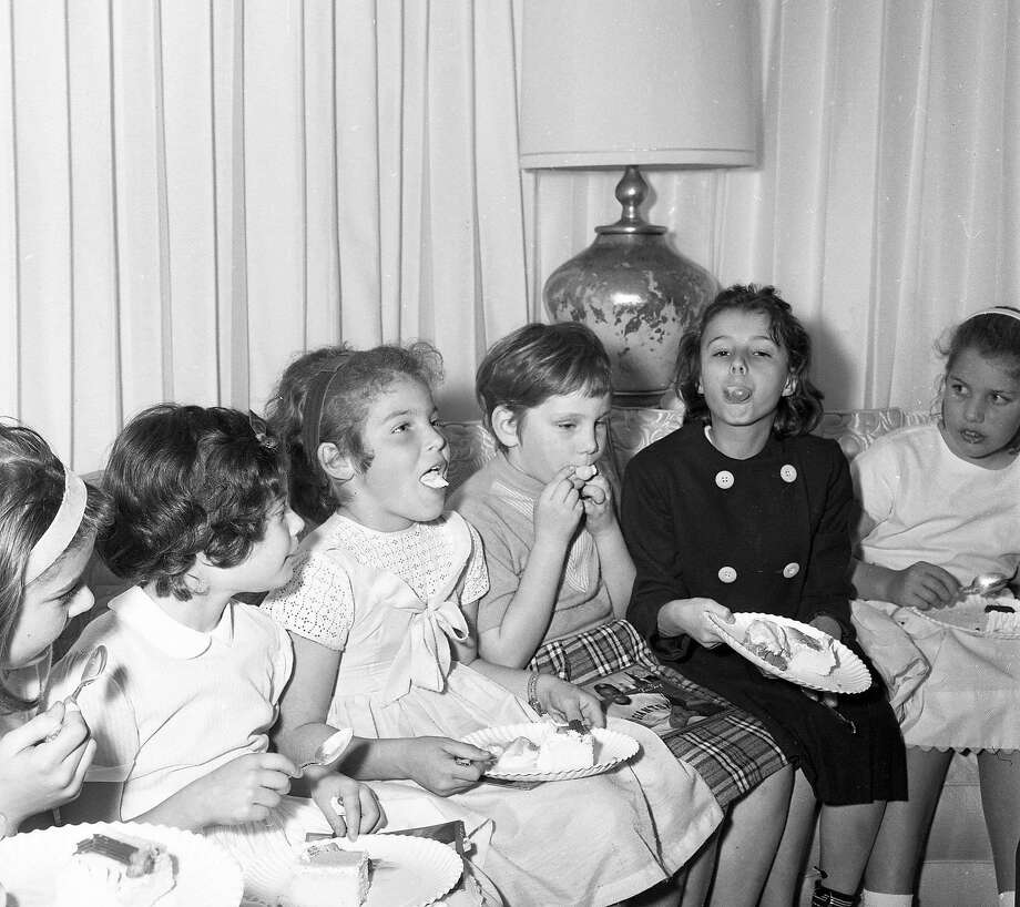 Feb. 16. 1963: Children eat cake and ice cream during a party at Willie Mays' house in San Francisco. The Giants players invited his neighbors. Photo: John McBride, The Chronicle