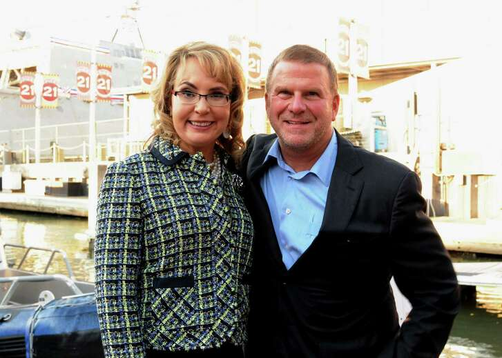 Gabrielle Giffords and Tilman Fertitta at the USS Gabrielle Giffords Commissioning VIP pre-party on Fertitta's yacht.