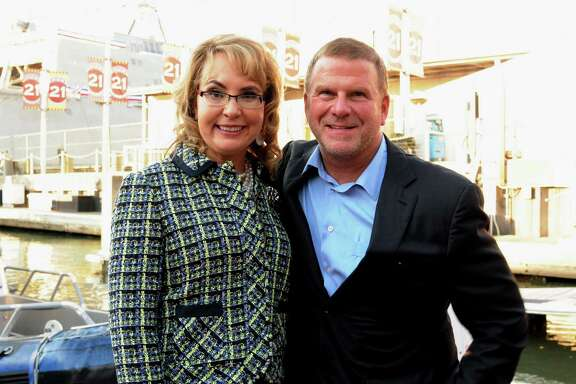 Gabrielle Giffords and Tilman Fertitta at theUSS Gabrielle Giffords Commissioning VIP pre-party on Fertitta's yacht.
