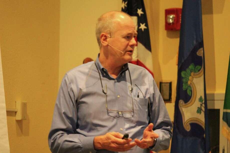 Glenn Chalder, from Planimetrics, presents key aspects of the 2017 Plan of Conservation and Development. Photo: Chris Marquette / Hearst Connecticut Media / Westport News