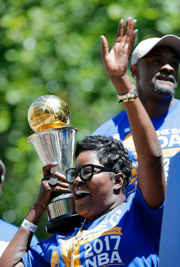 Wanda Durant holds her son's MVP trophy along the parade route during the Golden State Warriors NBA championship victory parade through downtown Oakland, Ca., on Thursday June 15, 2017. Photo: Michael Macor, The Chronicle