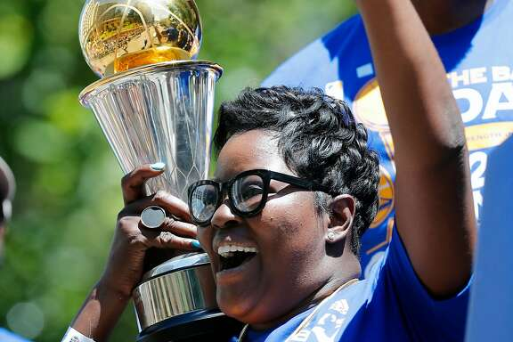 Wanda Durant holds her son's MVP trophy along the parade route during the Golden State Warriors NBA championship victory parade through downtown Oakland, Ca., on Thursday June 15, 2017.