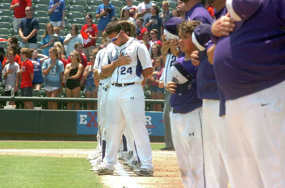 Senior Holden Lane places his hand over his heart, along with the rest of the Port Neches-Groves baseball team, as the National Anthem is played before the start of the Class 5A state baseball final with Grapevine on Saturday, June 10 at Dell Diamond in Round Rock. (Mike Tobias/The Enterprise) Photo: Mike Tobias/The Enterprise