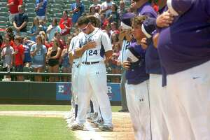 Senior Holden Lane places his hand over his heart, along with the rest of the Port Neches-Groves baseball team, as the National Anthem is played before the start of the Class 5A state baseball final with Grapevine on Saturday, June 10 at Dell Diamond in Round Rock. (Mike Tobias/The Enterprise)