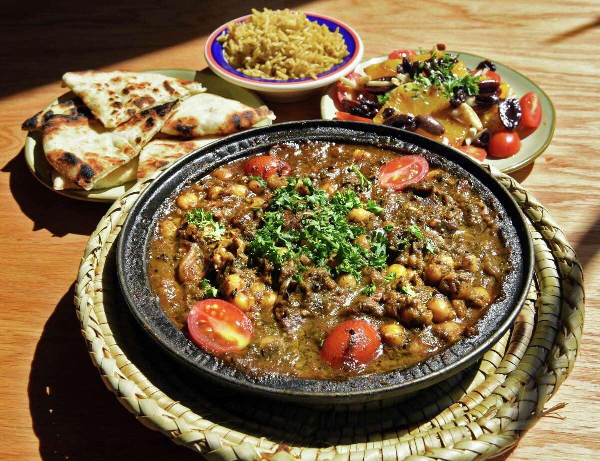 Lamb with chick peas in parsley Chermoula served with orange salad, pita and rice at Tara Kitchen on River Street Wednesday June 7, 2017 in Troy, NY. (John Carl D'Annibale / Times Union)