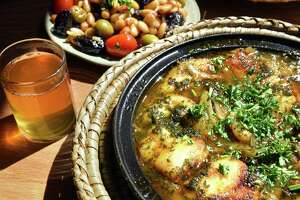 Fish with honey served with fig salad and Moroccan mint tea at Tara Kitchen on River Street Wednesday June 7, 2017 in Troy, NY.  (John Carl D'Annibale / Times Union)