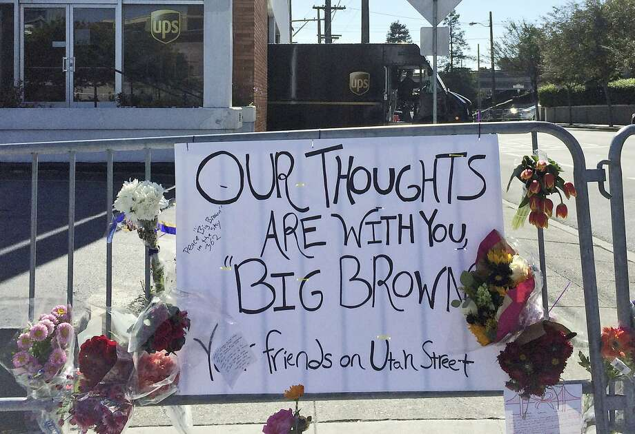 Flowers are left at the UPS building in San Francisco where a gunman fatally shot three co-workers Wednesday before killing himself. Photo: Paul Elias, Associated Press
