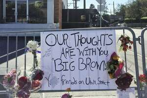 Flowers are left at the UPS facility in San Francisco, Thursday, June 15, 2017. Officials say UPS employee Jimmy Lam shot and killed three fellow UPS drivers Wednesday before fatally shooting himself in the head in front of police officers. (AP Photo/Paul Elias)