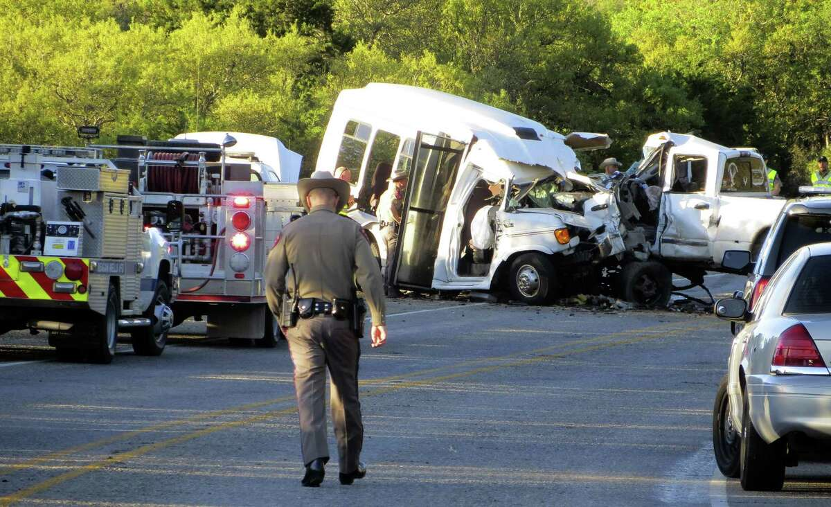 Authorities investigate after a deadly crash involving a van carrying church members and a pickup truck on U.S. 83 outside Garner State Park in northern Uvalde County March 29. The crash killed 13. The driver of the car that caused the accident was reportedly texting.