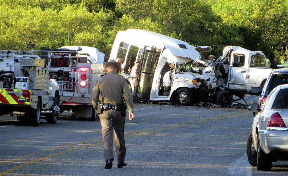 Authorities investigate after a deadly crash involving a van carrying church members and a pickup truck on U.S. 83 outside Garner State Park in northern Uvalde County March 29. The crash killed 13. The driver of the car that caused the accident was reportedly texting. Photo: Zeke MacCormack /AP / Stratford Booster Club