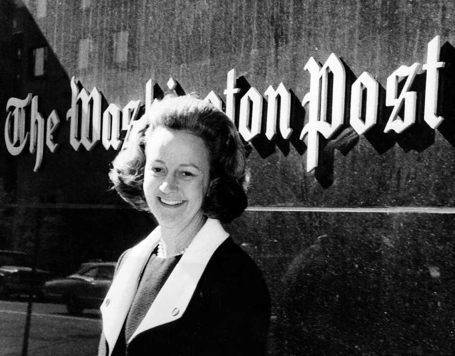 Katharine Graham in front of The Washington Post building shortly after becoming publisher. By the time she stepped down as chief executive in 1991 and as chairman in 1993, the company had become a diversified media corporation with newspaper, magazine, television, cable and educational services businesses. Photo: Washington Post File Photo / The Washington Post
